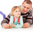 Daddy hugged the little girl, lying, posing — Stock Photo #14025948