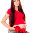 Pregnant girl with a red bow on her stomach — Stock Photo #14026165