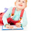 The little girl draws — Stock Photo #14027380