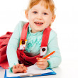 The little girl tries to draw — Stock Photo #14027559