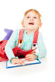 The little girl draws — Stock Photo