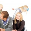 Happy family with small children — Stock Photo