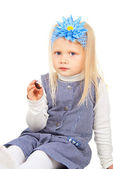 Child sitting with chocolate candy — Stock Photo