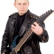 Rock guitarist in the leather clothing — Stock Photo