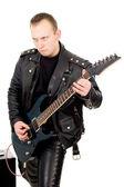 Guitarrista de rock en prendas de cuero, con equipos de amplificación de sonido — Foto de Stock