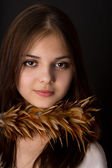 The girl Brunet with feathers posing — Stock Photo
