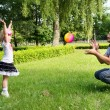 Dad plays with her daughter with the ball — Stock Photo #28937695