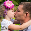 Happy family, dad kissing daughter — Stock Photo