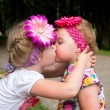 Little girl kisses its little sister — Stock Photo