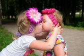 Little girl kisses its little sister — Stock Photo
