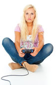 Girl playing video games on the joystick — Stock Photo
