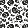 Seamless pattern of pumpkins and skulls — Stockvektor