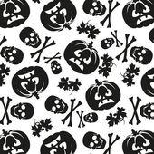 Seamless pattern of pumpkins and skulls — Stock Vector