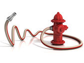 Fire hydrant with fire hose — Stock Photo