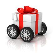 Caixa de presente sobre rodas — Fotografia Stock
