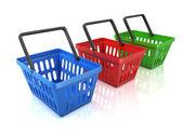 Colorful shopping baskets isolated on white background — Stock Photo