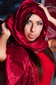 Beautiful girl in the eastern red kerchief — Stock Photo