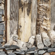 Fire wood pile near the plank wall - Stock Photo