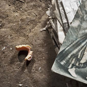 Denture on the ground in old house — Stock Photo