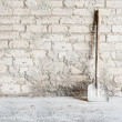 Royalty-Free Stock Photo: Grunge wall background at the mill, shovel near the wall