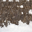Stock Photo: Plank wall of old wind mill background, winter time, snow on the