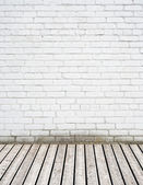 White brick wall and wooden floor — Stock Photo