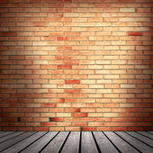 Red brick wall and wooden floor — Stock Photo