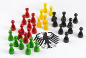 Game figures with federal eagle — Stock Photo