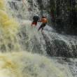 Stock Photo: Rappelling Down Waterfall