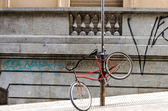 Bicycle Chained to a Post — Stock Photo