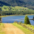 Country Road and Lake — Stock Photo