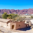 Rustic Adobe Building and Red Hills — Stock Photo #51000045