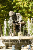 Spanish fountain in a garden — Stock Photo