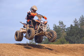 Teen rider in jump above the horizon — Stock Photo