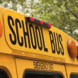 Back of school bus with a sign — Stock Photo #14043793