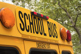 Back of school bus with a sign — Stock Photo