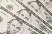 Background with money US dollar bills (5$) — Stock Photo