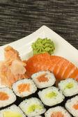 Maki rolls and nigiri sushi on a plate — Stock Photo
