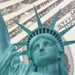 Statue of Liberty and Dollars background — Stock Photo