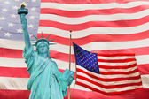 Statue of Liberty and Two American flag — Stock Photo