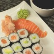 Sushi on a plate with soy sauce — Stock Photo
