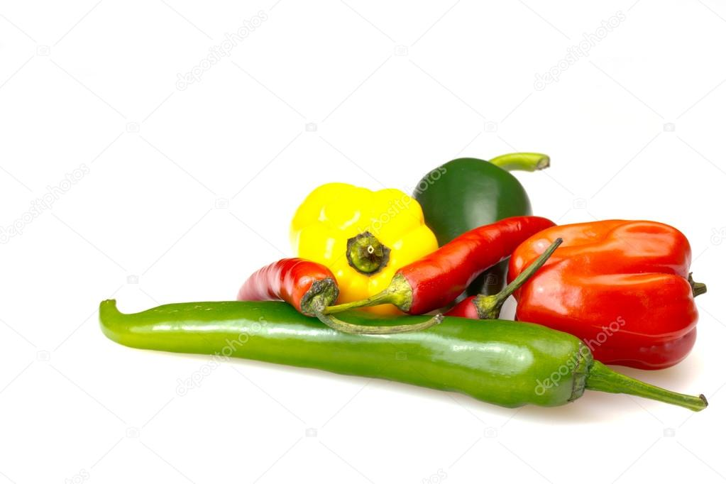 Group of green, red and yellow chilli peppers. Long and round together. Isolated. — Stock Photo #20045405