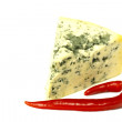 Blue cheese  with red chilli peppers — Stock Photo