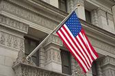 American flag hanging on the historic building. — Stock Photo