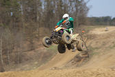 Dynamic shot of quad racer jump — Stock Photo