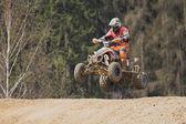 Jump with quad motorbike — Stock Photo