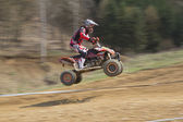 Dynamic shot of young racer jump — Stock Photo