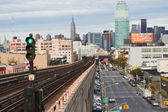 View of morning traffic on Queens Boulevard (NYC) — Stock Photo