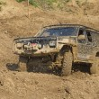 Stock Photo: Off-road vehicle in muddy terrain.