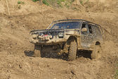 Off-road vehicle in muddy terrain. — Stock Photo